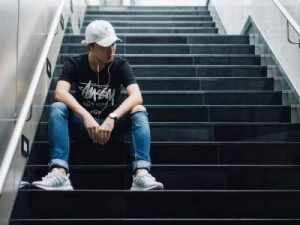 teen boy sitting on steps
