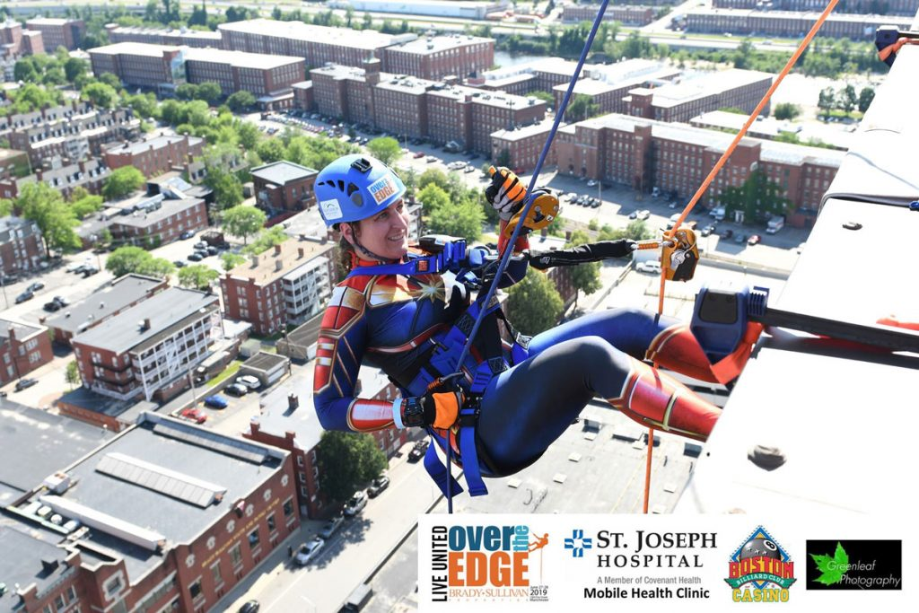 Person rappelling off a building